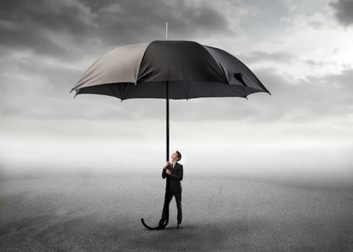 crisis man with an umbrella storm